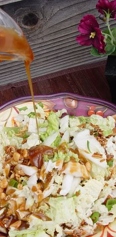 Chinese Cabbage Salad Changes made: add 2 cans of Mandrin oranges (in light syrup) and add a little if the syrup to the dressing and add grilled chicken Also: best if dressing is made night before then refrigerated overnight and added to salad cold