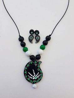 Handmade terracotta jewelry - This jewelry is made of red/black natural clay. Molded to beads, various shapes/designs and then burnt to harden. Finely hand-painted and finally finished with threading and earring hooks/posts. - Mix and match with any dress type.
