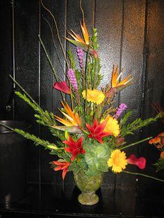 arrangement with birds, lilies, gerberas, liatris, callas and kale