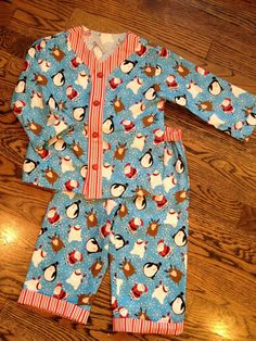 https://flic.kr/p/dwK7aQ | Sleepover Pajamas Size 2t top 18-24 bottom | I found this cute print at Joann's and the fabric quality seems pretty good.  I thought it would make the perfect fun PJ's for my son.  Super loud and Christmas Tacky... Exactly as they should be.