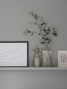 Grey shelf with Desenio figurative print and greenery. IKEA Mosslanda picture ledge. Getting the guest bedroom ready – an Emma mattress review