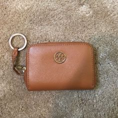 Tory Burch Wallet flaws: key fob rusted, small red dot on the back, and key strap--price reflects flaws--negotiations are not done through comments, please make an offer--Happy Poshing! Tory Burch Bags Wallets