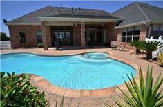 Gorgeous high end home on large 2+acre lot  features 4 car garage, covered patio, sparkling pool, open plan w/high ceilings & lots of windows with room for RV garage. $649000 http://www.amandahomes.com