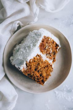 Simple vegan carrot cake with cashew frosting #vegan #carrotcake #valentines #foodstyling #foodphotography #dessert #cashewfrosting| TheAwesomeGreen.com