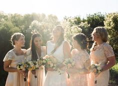 Love the natural look of the unmatched bridesmaid dresses, with just a perfect amount of lace.