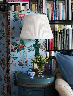 Room of the Day ~ Chintz, turquoise, books, crystal lamp - Joe Nye's Bel Air apartment (photo: Roger Davies) 4.5.2013