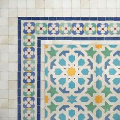 a hand painted tile border pattern is repeated on these stair ...