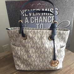 MK Jet Set Large Tote Navy Blue Slightly used but in great condition. Has small stain on the inside but its not bad. Havent tried cleaning it because im not sure if I should use any special cleaner. Michael Kors Bags Totes