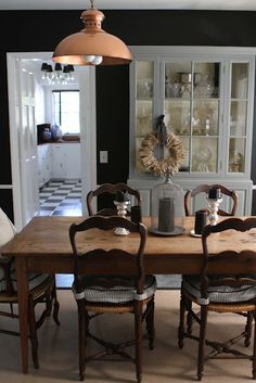 Love the mix of reclaimed wood, french country and painted sideboard