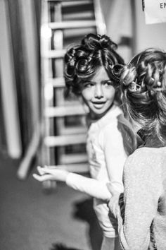 Curled locks and ready to dress, kid models backstage at the Fashion from Spain kids fashion show at Pitti Bimbo