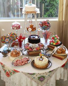 Cute sweets table for a party.  Like the cheerful vintage hanky treatment on the tablecloth.