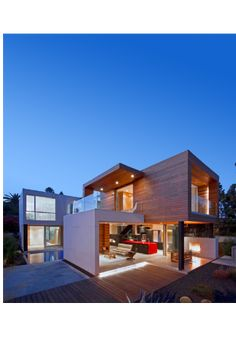 Quality design, net-zero energy efficiency, minimal construction waste, pre-cut, pre-drilled kit house - assembled on site. I love the wood/white/open floor plan/glass balconies/pool/large windows. Great design!