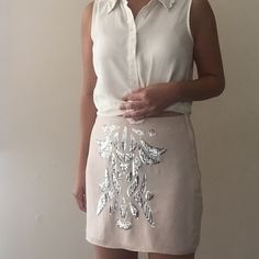H&M mini skirt with silver sequin detailing Love this skirt! It's light and airy and feminine. Barely noticeable stain on the skirt as pictured. H&M Skirts Mini