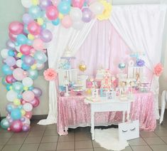 Loving the dessert table and balloon garland at this Unicorns Birthday Party!! See more party ideas and share yours at CatchMyParty.com #unicornbirthdayparty #desserttable