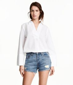 Check this out! Short 5-pocket shorts in washed denim with heavily distressed details, high waist, button fly, and raw-edge hems. - Visit hm.com to see more.