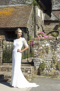 This is a one off Decobridal wedding dress.  1930s vintage style bias cut wedding dress made with delicate chiffon and French lace. This exquisite style features a stunning low lace panel back and sleeves, perfect for maximum wow impact as you walk up the aisle. It also has a gorgeous puddle train and satin tie at the waist, and delicate hand appliqued lace flowers at the boned bodice. Its empire line is super flattering, and the bias cut fabric fits and falls in all the right places.  The…