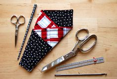 Miss Sews-It-All shows how you can make this quilted scissors case. It has 3 pockets to hold scissors and small sewing notions like a seam…
