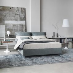 Nathalie Bed's headboard is upholstered and padded, like the base, with fabric, leather or Ecopelle covers that can be completely removed thanks to the practical Velcro fasteners; it can also be reclined with a manual mechanism.  The cushion covers of the headboard allow the pillows to be stored and protected from dust. http://www.switchmodern.com/Beds/Flou-Nathalie-Bed.asp