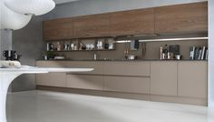 System, in book-matched, Elm wood wall cabinets and frosted glass base cabinets.