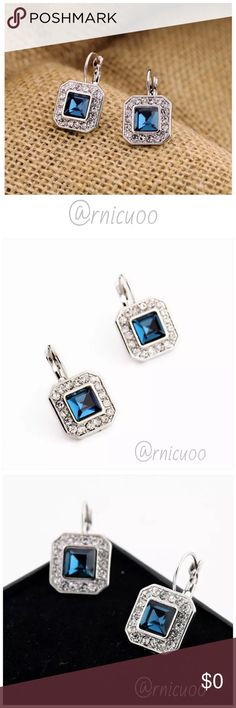 "Square Silver Blue Crystal Gem Drop Earrings! Gorgeous Square Silver Drop Earrings with a Sparkling Blue Center Stone surrounded by Clear Crystal Pavé Stones! For pierced ears, lever back style!  • Nickel & Lead Free Antique Rhodium Plating • Clear Crystal Pavé & Blue Crystal Stones  ➖Prices Firm, Bundle for 20% Discount ➖""Trade"" & Lowball Offers will be ignored ➖Sales are Final, Please read Description & Ask Any Questions! Boutique Jewelry Earrings"