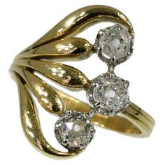 Typical Art Nouveau diamond engagement ring. Three old mine brilliant cut diamonds with a total estimated weight of approx. 1.00 crt.