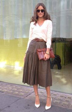 Olivia Palermo wearing a Hermes Jige cluctch, Reiss Andrea shirt & a Reiss Barrett Midi leather skirt.