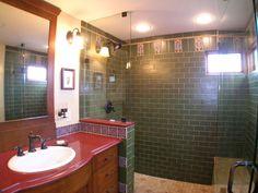 Bathroom in Tudor home has custom tile unique colors