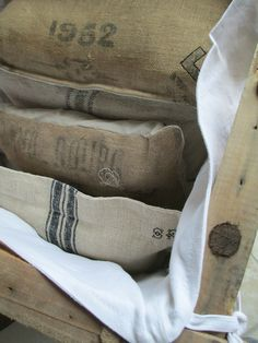 ..old grain sacks. We have cathedral ceilings in our game room at home. I had my hubby put in beams' and some cross beams' which has been a great way to display items from our travels, antiques, gifts and unique pieces we've come across over the years.. SO of course I have a couple of old/antique grain sacks and such!  :P