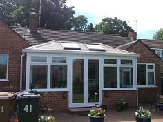 Transform your conservatory with a Tiled Roof Replacement from Abbey & Burton Glass. Warm Roof, Roofing Systems, Conservatory, Garage Doors, Outdoor Decor, Home Decor, Decoration Home, Room Decor, Winter Garden