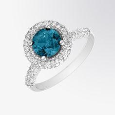 Blue diamond and diamond halo ring #FifthBond