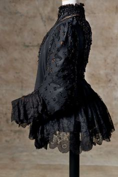 1890 Worth jacket in black silk satin embroidered in jet black, silk black lace. Donation Ms. Joelle Almagia.