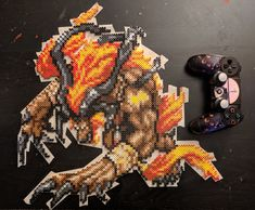"Final fantasy ifrit perler bead. Approximately 18x18"" in width and height."