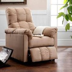 Add style and comfort to a living room, den, nursery or bedroom with the microfiber recliner. Featuring a tall back, wide padded arms and a thickly padded seat for added comfort You will enjoy sitting in total support. The microfiber fabric on the back, arms and footrest are gathered at the center seams for added beauty. To raise the footrest, simply lean back and recline the chair with the convenient smooth push-back reclining mechanism. This slim recliner will easily become your favorite…