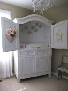 An old tv armoire repurposed to a changing table