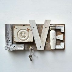 So cool love picture frame edge,corner wood medallion,furring strips,half of spindle, more pic frame parts on plank of wood. I like color so would paint it beautiful beach colors or put some design to the letters in color