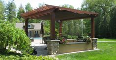 Rustic style cedar pergola kit featuring a retractable canopy to provide sun and rain protection!
