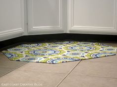 I ADORE this idea! Homemade fabric/rubber floormat/rug. Hooray