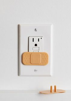 Creative Ouch-let Cover Set, #ModCloth Plastic. Measures approximately 2.5 x 1.25 inches. Set of four outlet covers. Fits standard United States outlets. Imported USD$7.99 So cute!!