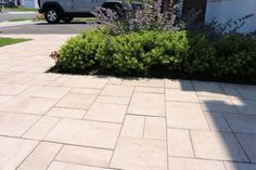Walk up to your front door in style, only with Cambridge Pavingstones with ArmorTec. Installation: Design & Build Landscape