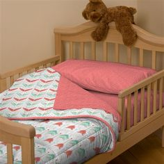 Enchanting coral bedding on teal arrow crib bedding carousel designs with wood floor and beige wall