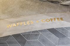 Brass waffle signage inlayed in concrete