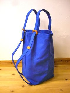 富澤英子さんのリュット きりっとした組み合わせの、青(帆布)×キャメル(レザー) お客様のご希望で、定番の形より、ストラップの巾を広くしたものです。 ...