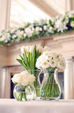 unusual but effective idea - single color, one type of flower per vase, lots of different vases