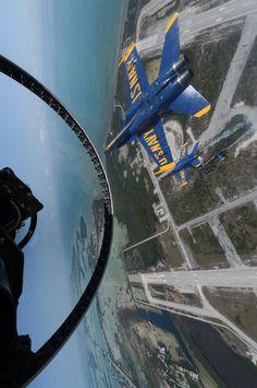 U.S. Navy flight demonstration squadron, the Blue Angels, pilots perform the tuck under break maneuver over Naval Air Station Key West, Fla.