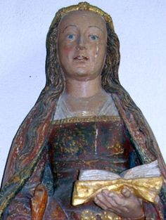 photograph of a detail of a statue of Saint Susanna of Rome, Church of Saint-Suzanne, Mayenne, France; sculptor unknown, date unknown