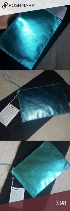 NEW! Metallic teal/blue genuine leather clutch New wirh tags, purchased in Italy . Amazing color! Bags