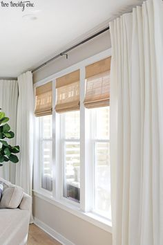 Living room window treatments featuring budget-friendly cordless woven shades an. Living room window treatments featuring budget-friendly cordless woven shades and linen cotton curtains, paired with black curtain rods. Bedroom Windows, Living Room Windows, Home Living Room, Living Room Designs, Living Room Window Treatments, Modern Window Treatments, Home Windows, Family Room Curtains, Modern Living Room Curtains