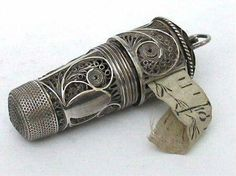 Antique filigree silver thimble with tape measure. It includes a tiny glass perfume bottle which fits into the thimble. A sewing notion meant to be hung from a chatelaine, circa, Sewing Box, Sewing Tools, Sewing Crafts, Sewing Projects, Sewing Kits, Sewing Case, Vintage Sewing Notions, Antique Sewing Machines, Objets Antiques
