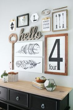 Gallery wall without using pictures or mirrors. I love the feather graphics and large wooden key.