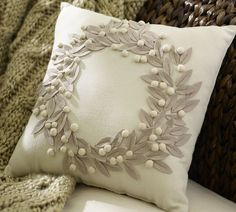 Pottery Barn knock-off Christmas pillow - glue on felt leaves and small pom poms to make a pretty wreath. Can go over leaves with stitching.